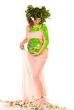 Pregnant woman with body-art with green leaves Stock Photography