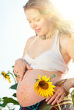 Pregnant Woman with Bodyart. On her Belly and Hands royalty free stock images