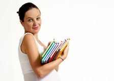 The pregnant woman with books Royalty Free Stock Photos