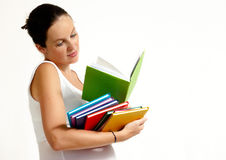 The pregnant woman with books Royalty Free Stock Photography