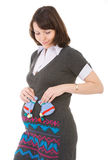 Pregnant woman and bootee. Woman watching to the baby's bootee Royalty Free Stock Photo