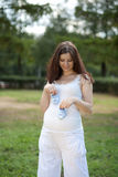 Pregnant woman with booties Stock Image