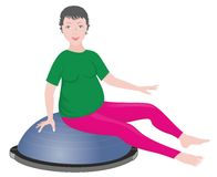 Pregnant woman on the BOSU Stock Images