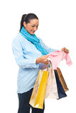 Pregnant woman bought baby clothing Stock Image