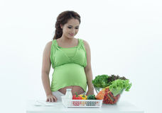 Pregnant woman with bowl of salad. Stock Photography