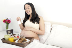 Pregnant woman breakfast in bed Royalty Free Stock Photography