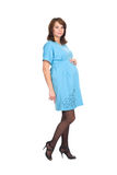 Pregnant woman, a brunette, in a blue dress Stock Image
