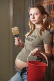 Pregnant woman builder Royalty Free Stock Images