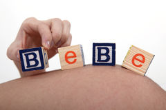 Pregnant woman with building blocks Royalty Free Stock Photos