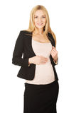 Pregnant woman in business suit. Royalty Free Stock Images