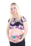 Pregnant woman with butterflies on Royalty Free Stock Images