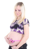 Pregnant woman with butterfly on Royalty Free Stock Photography