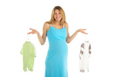 Pregnant woman buying baby clothes Stock Photos