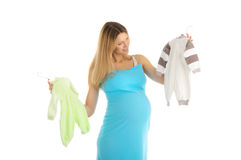 Pregnant woman buying baby clothes Royalty Free Stock Photos