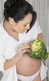 Pregnant woman with cabbage Stock Photography