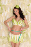 Pregnant woman in cabbage measure your stomach Stock Photo