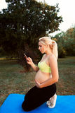 Pregnant woman call doctor close-up Stock Photography