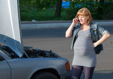 Pregnant Woman Calling for help Broken Car Stock Images