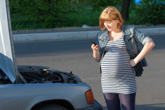 Pregnant Woman Calling for help Broken Car Stock Photo