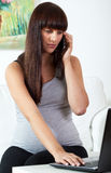 Pregnant woman calling on mobile phone Royalty Free Stock Image