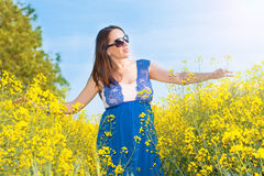 Pregnant woman in canola field Royalty Free Stock Photography