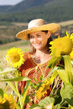 Pregnant woman in cap standing on field Stock Photography