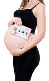 Pregnant woman with card Royalty Free Stock Images