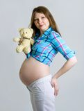 Pregnant woman caressing her belly Royalty Free Stock Images