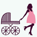 Pregnant woman with carriage. Stock Images
