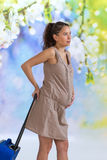 Pregnant woman carrying suitcase and ready for maternity hospital Stock Photos