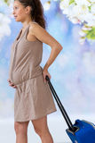 Pregnant woman carrying suitcase and ready for maternity hospital Stock Photo