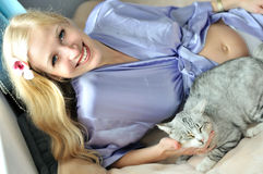 Pregnant woman with cat Royalty Free Stock Photo