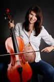 Pregnant woman with cello Stock Images
