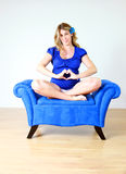 Pregnant woman in chair Royalty Free Stock Images