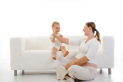 Pregnant woman with child Stock Images