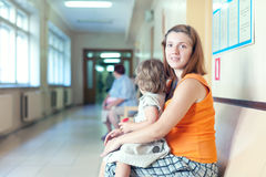 Pregnant woman with child   at the clinic Royalty Free Stock Photos