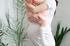 Pregnant woman with child, pregnancy belly,mother and daughter. Happy motherhood. Expecting baby birth in third trimester Stock Images