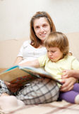 Pregnant woman and child reads  book Royalty Free Stock Photos