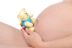Pregnant woman with child's toy Royalty Free Stock Photography