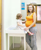 Pregnant woman with child waits to doctor receive Royalty Free Stock Photography