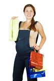 Pregnant woman with  children's wear Royalty Free Stock Images