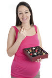 Pregnant woman with chocolates Stock Photo