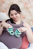 Pregnant woman chooses children's things Royalty Free Stock Photo