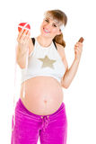 Pregnant woman choosing healthy lifestyle. Royalty Free Stock Images
