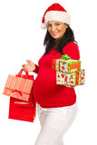 Pregnant woman with Christmas gifts Royalty Free Stock Photos
