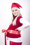 pregnant woman with christmas hat bow Stock Image