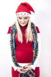 Pregnant woman with christmas hat, decorations Royalty Free Stock Images