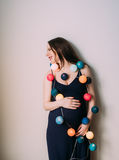 Pregnant woman with christmas lanterns laughs Royalty Free Stock Photos