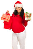 Pregnant woman  with Christmas shoppings Royalty Free Stock Image