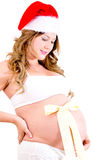 Pregnant woman at Christmas time Royalty Free Stock Photography